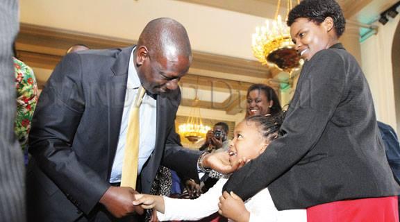 William Ruto and Kimberly Njoroge