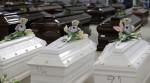 coffins of African migrants in Lampedusa