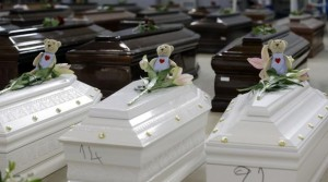 coffins of African migrants in Lampedusa