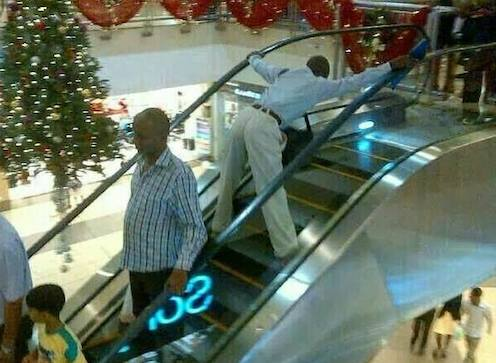 Mshamba in town man on escalator