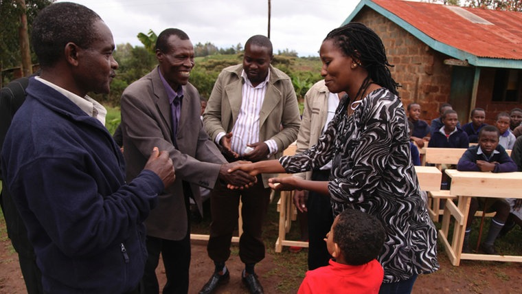 Muthoni handing over the desks to Ndurutu Primary