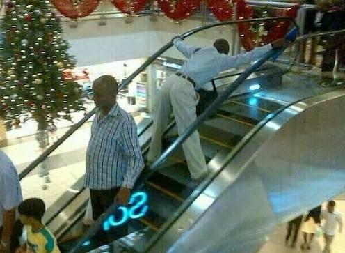 Mshamba in town man on escalator