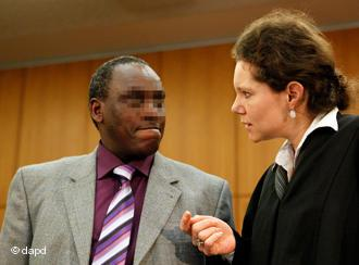 Onesphore Rwabukombe and his lawyer Natalie von Wistinghausen in the court room in Frankfurt