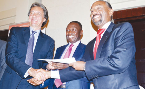 AfDB's Regional Director Gabriel Negatu (right), Ministry of Energy Principal Secretary Joseph Njoroge (centre) and LTWP chairman Carlo van Wageningen at the signing of a loan agreement Monday