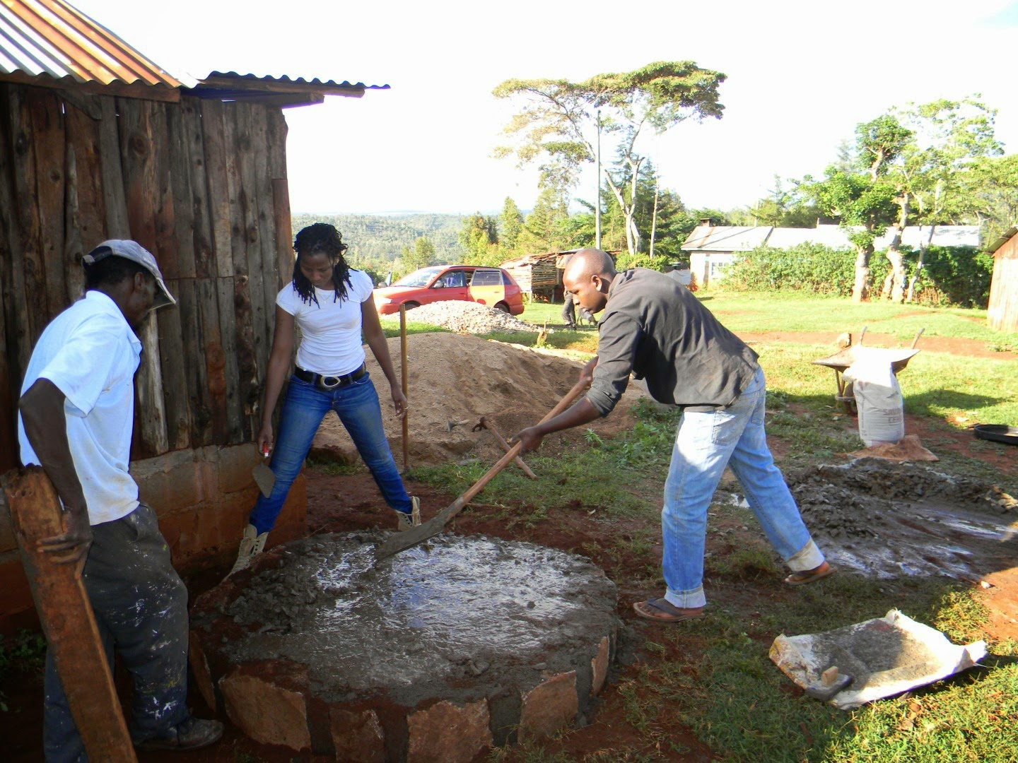 Muthoni and the Kedovo team working on the foundation of a water tank