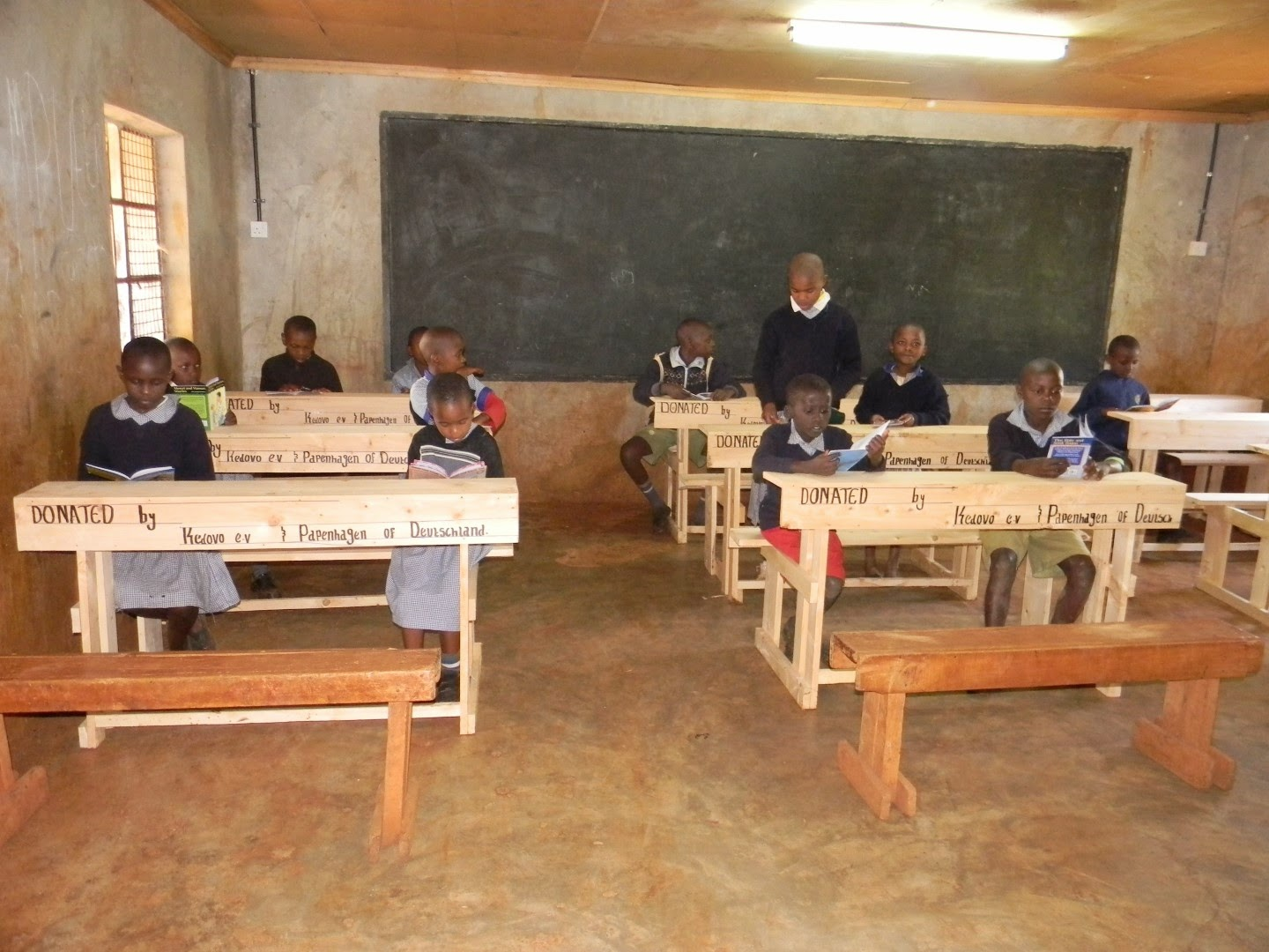 A classroom with the new desks donated by Kedovo e.V. and their partners
