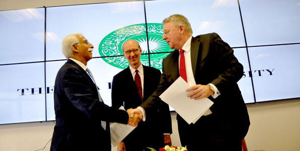 The Aga Khan University president Firoz Rasul (left), Graduate School of Media and Communications dean Michael Meyer and Deutsche Welle director-general Peter Limbourg